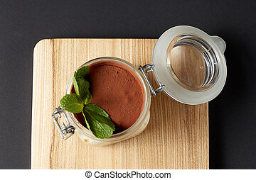 tiramisu with mint in a glass jar