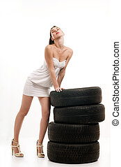 Tire and woman - Young sexy woman like vulcaniser with a...