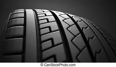 Tire close up. - Close up on a tire on a dark background.