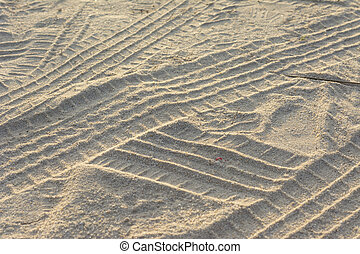 Tire from tracks on the sand texture background