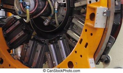 Tire manufacture robotic machine close up - Tire production...