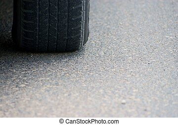 tire on road.