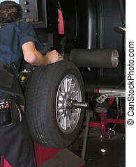 Tire on spin balance machine - computerized spin balancing a...