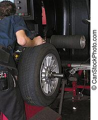 Tire on spin balance machine - computerized spin balancing a...