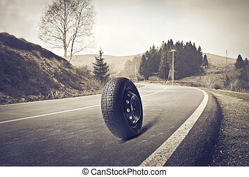 tire on the road - tire rolls on the road when cornering