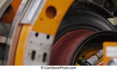 Manufacture of tires - Tire production machine close up....