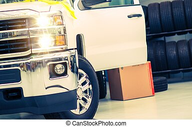 Tire Replacing Service. Pickup Truck in the Tire Service.