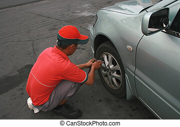 tire service - station crew providing free tire air checkup...