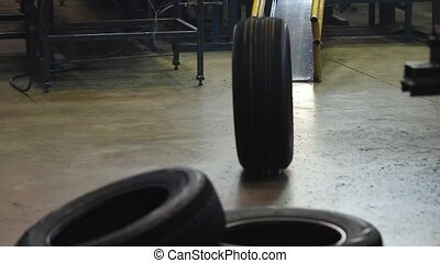Tire sorting at a large tire factory. - New tires after...