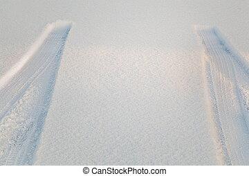 Tire track in snow in winter
