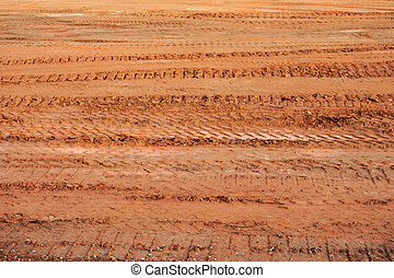 tire track on dirt in construction