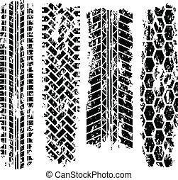 Tire tracks - Four black grunge tire tracks