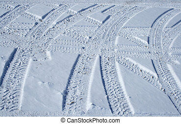 Tire tracks crossing the snowy terrain - Vehicle tracks...