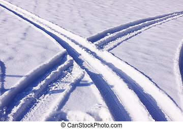 tire tracks in the snow in winter