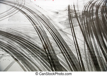 Tire tracks on asphalt - tire tracks on asphalt in snow