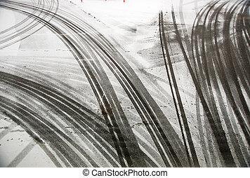 Tire tracks on asphalt - tire tracks on asphalt in snow