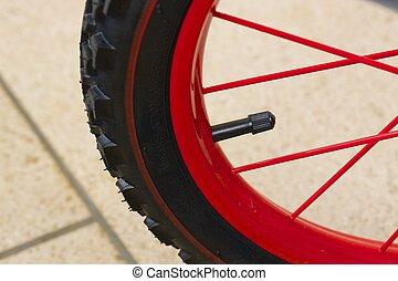 Tire valve. Closeup - Tire valve on a kids bike. Closeup
