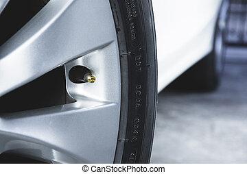 Tire valve stem without caps - Close up of tire valve stem ...