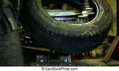 Tire wear on the wheel - At the station of the service being...