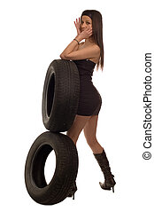 Tire - Young sexy girl holding a car wheel