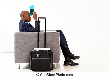 tired african American businessman resting