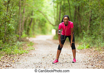 Tired African american woman jogger portrait - Fitness, people and healthy lifestyle