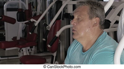 Tired after training man showing thumb-up