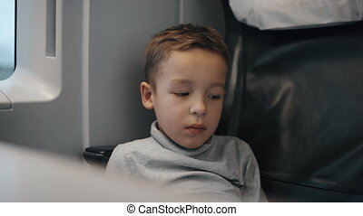 Tired and bored kid traveling by train - Cinemagraph - Tired...