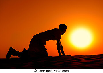 Tired and weaken man on all fours on sunset - Tired and...