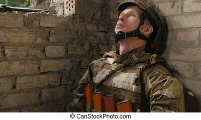 Tired army soldier relieving stress with cigarette