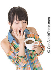 Tired asian woman with cup of coffee