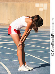 Tired athlete - Tired girl on a blue racetrack