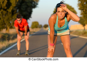 Tired athletes after running hard - Tired fitness couple of...
