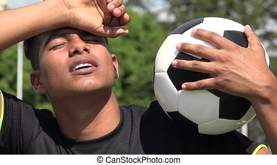 Tired Athletic Teen Male Soccer Player And Exhaustion
