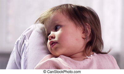 Tired Baby - Tired little girl leaning against her mother%...