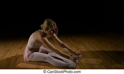 Tired ballet dancer illustrating concept of hard work in achieving dreams