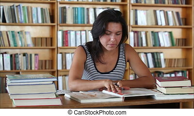 student in the library - tired beautiful girl student in the...