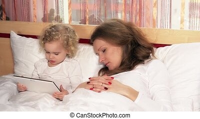 Tired beautiful mother woman fall asleep while daughter...