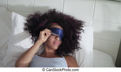 Tired Black Girl Waking Up In Bed With Sleep Mask - Lazy...