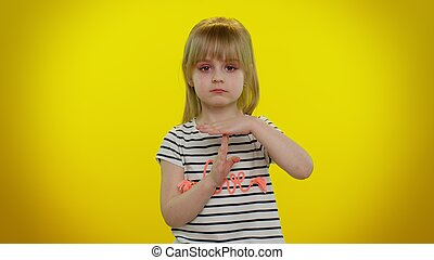 Tired blonde child girl showing time out gesture, limit or stop sign no pressure, i need more time