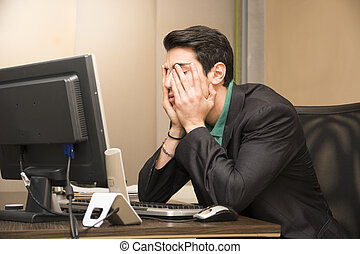 Tired bored young businessman in office - Tired bored young...