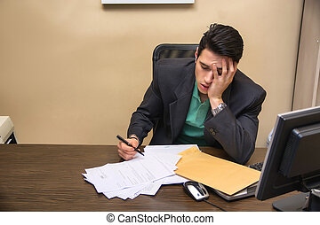 Tired bored young businessman sitting in office yawning -...