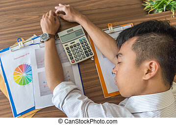 Tired business employee sleeping on the financial report
