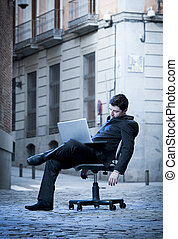 Tired Business Man sitting on Office Chair on Street sleeping