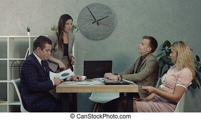 Tired businessman falling asleep in meeting - Anxious female...