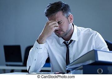 Tired businessman in the office - View of tired businessman...