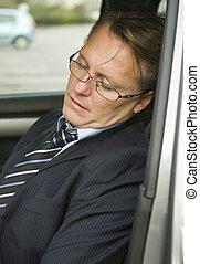 Tired businessman sleeping - A Tired businessman has fallen...