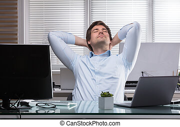 Tired Businessman Stretching His Arms