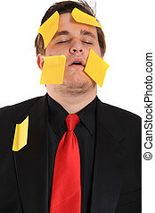 Tired businessman with sticky note paper