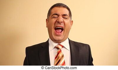 Tired businessman yawning and stretching - Exhausted -...
